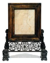 A steatite table screen on a wooden stand. China, Qing dynasty, ca. 1900. D. 51 x 17,5 x 39 cm (20 1/16 x 6 7/8 x 15 3/8 in.)