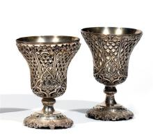 PAIRE DE BEAUX PORTE-CUILLÈRES «SHERBETLIK» en argent double corps, le premier lisse, le deuxième ajouré à décor de rinceaux et volu...