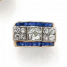 ANNÉES 1935 BAGUE CHEVALIÈRE à ROULEAUX ornée au centre de neuf diamants taille brillant (TA) encadrés par deux lignes de saphirs ca...