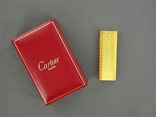 CARTIER BRIQUET A gold platted lighter by Cartier.