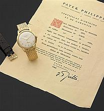 PATEK PHILIPPE DISCO VOLANTE. Réf. 2551, VERS 1956 Montre bracelet en or jaune avec boîtier rond godronné et fond vissé. Cadran arge...