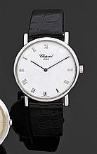 CHOPARD Montre bracelet avec boîtier rond en or gris. Cadran blanc avec index chiffres romains appliqués. Mouvement automatique méca...