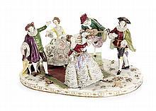 ALLEMAGNE Grand groupe à cinq figures sur une base ovale, l'un jouant de la guitare et les autres dansant, décor polychrome