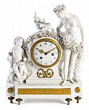 A Louis XVI porcelain biscuit and ormolu-mounted clock, in the manner of Boizot. Height. 14 15/16 IN. - WIDTH. 11 1/4 IN. - DEPTH. 5 1/