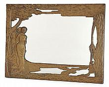 Francis-Rupert Carabin (1862-1938) Miroir rectangulaire, structure en bois, circa 1898, à entourage en cuivre patiné repoussé en bas...