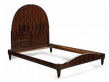 ÉMILE-JACQUES RUHLMANN (1879-1933) Élégant lit deux places, modèle Katz, circa1923, en placage d'ébène de Macassar, la tête de lit f...