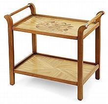 André GROULT (1884-1967) Table desserte à deux plateaux, structure en chêne, piétement gaine se terminant en crosses, prises cylindr...