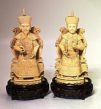 A Pair of Chinese Ivory Figures of Seated Deities,
