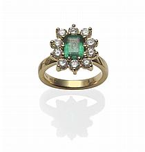 An 18 Carat Gold Emerald and Diamond Cluster Ring,