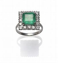 An 18 Carat White Gold Emerald and Diamond Cluster
