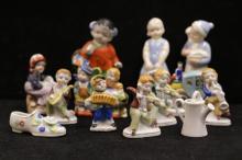 Fourteen Porcelain Figures