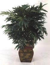 Artificial greenery in decorative planter