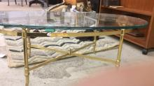 Brass and glass oval cocktail table