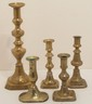 Lot of Brass Push Up Candlesticks