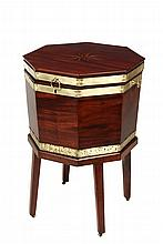 ENGLISH CELLARET - George III Brass Bound Mahogany Octagonal Wine Cooler, circa 1780, having a hinged lid having an inlaid compass rose, with a drop ring lift handle and a pair of oval shaped carrying handles on the s...