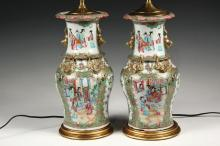 PAIR OF CHINESE PORCELAIN VASES AS LAMP BASES - Exceptional Rose Medallion Baluster Vases, late 18th c, having rolled scalloped rims, the neck with a pair of gilt foo lion lugs, four gilt salamander mounts at the shou...