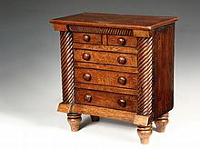SALESMAN'S SAMPLE CHEST - Miniature Federal Style Oak Chest, early 19th c., having overhanging top with carved v-frieze, two short simulated drawers over three long graduated drawers, all with ebonized beaded edges, w..