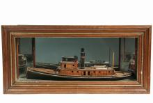 CASED SHIP MODEL - Full Hulled Builder's Model in Mirrored Diorama of the Seagoing Tug 'Raven', the boat is set loose into a painted ground, the face of the case having walnut and gold molded frame, appears never to h