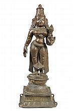 EARLY INDIAN BRONZE DEITY - Finely Cast Standing Figure of the Bodhisattva Padmapani, Central India, 17th to 18th century, depicted holding a lotus in left hand, wearing a diaphanous dhoti and Royal headress, the figu...