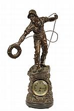 NAUTICAL THEMED CLOCK - Simulated Bronze Spelter Figure of a Lifesaver on the bow of his boat preparing to toss his life ring, wind-up clock set into waves at prow, early 20th c
