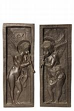 PAIR OF ITALIAN BRONZE PLAQUES - Cast Bronze Plaques after Donatello, 19th century or earlier, featuring standing Cherubs blowing horns, set within deep panels having incised geometric decoration, 22 1/2