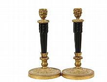 PAIR OF FRENCH CANDLESTICKS -  Empire Parcel Gilt and Ebonized Bronze Candlesticks, the base and cup with martial symbols, the stem consisting of bundled arrows, the base of one faintly stamped