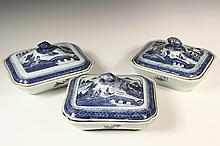 (3) CHINESE EXPORT SERVING PIECES - 19th c. Canton Porcelain, in Blue Willow pattern, including: Three Oblong Covered Dishes with domed lids having pomegranate form knops, lobed corners, similar, but not matching, all...