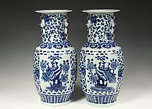 PAIR OF CHINESE PORCELAIN VASES - Canton Export, 19th c, baluster form with flared and scalloped rim, in typical blue and white glaze, having panels depicting a peacock and blossoms, overall ivy decoration, opposing b...