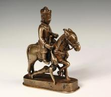 RARE TIBETAN BRONZE FIGURE - 17th c. Mongolian Warrior on Horseback, dragging captive by hair, seated in the distinctive saddle, with typical hat, sword and shield, 6 3/8