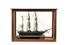 CASED SHIP MODEL - 19th c. Maine Sailor Made Model of the Bark 'Elsie' (mis-spelled 'Elcie') from Boston, built in Nova Scotia in 1868. Depicted with full rigging, no sails, on raised waterline platform, mounted insi