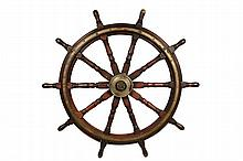 WHALING SHIP'S WHEEL - Large 19th c. Walnut and Bronze Ten-Spoke Wheel with bronze hub, iron spindle, bronze handle marking cap, the spindles turned, the handles quite large. Purportedly from the last whaler to dock i..