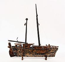SAILOR-MADE SHIP FORM BOX - Naive Tortoiseshell Covered Wooden Box in the form of a Chinese Junk, with brass trim and later monofilament rigging, hinged at the waterline along one side to reveal four black velvet line...
