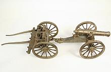 BRONZE DISPLAY MODEL OF CANNON AND LIMBER - Solid Bronze Display Model of a late 18th c. early single trail field cannon, complete with limber and accessories. Highly and accurately detailed. 9 1/2