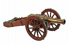MODEL OF 17TH-18TH C FIELD CANNON - Highly Detailed European Bronze Artillery Piece, having elaborate decoration of a grotesque and a regal face among scrollwork, with accurate iron-bound wooden double trail carriage