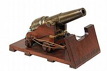 PROTOTYPE NAVAL GUN - Scale Naval Parrott Rifle on Carriage possibly a Patent Model, circa 1860, with cutaway shipboard platform and rigging, steel barrel having bronze finish, 9 1/2