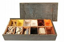 CIVIL WAR ERA HOUSE PAINTER'S PIGMENT BOX - Scarce Partitioned Box in dark green painted pine, with chamfered sliding lid revealing twelve compartments containing dry pigments, several are wrapped in
