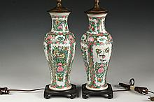 PAIR OF CHINESE PORCELAIN VASES AS LAMPS - Late 19th c. Rose Medallion Baluster Vases, with alternating panels of foliage with blossoms and foliage with blossoms and birds above, scallops over gilt band framing, on ca...
