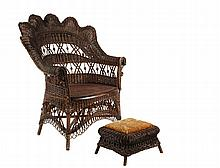 WICKER ARMCHAIR & FOOTSTOOL - Lounge Chair with Matching Footstool, in dark finish, unmarked but probably Heywood-Wakefield, circa 1885, the chair with scallop shell back in tight basketweave, open ranks have beadwork...