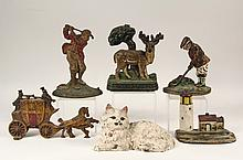 (6) VINTAGE CAST IRON DOOR STOPS - All in the original paint, circa 1890-1915, including: Hubley Reclining Cat in white and pink; John Wright Golfer and Wright Studios Golfer; London Royal Mail Coach; Deer with Tree a...