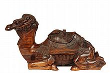 CARVED CAMEL INKWELL - 19th c. Palestinian Olivewood Inkwell in the form of a reclining camel, with detailed riding rig, hinged cap revealing spring-loaded sealing metal inkwell with glass liner. 10