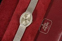 LADY'S WRISTWATCH - 18K White Gold and Diamond Oval Head Patek Philippe Wristwatch in original leather pouch; 6 1/2