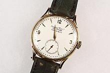 GENT'S WRISTWATCH - 14K Yellow Gold Presentation Wristwatch by International Watch Company, Schaffhausen, retailed by Tiffany & Co, with replaced leather band. Engraved on back