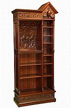BOOKCASE/DESK - Fine Hand Carved Custom Mahogany Free Standing Bookcase in architectural form, circa 1890, having narrow adjustable shelves on the right and fixed writing surface with shelves beneath on the left. Orna...