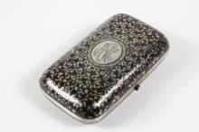 CHEROOT CASE - Russian 84-Silver Niello Two-Color Cheroot Case with black and copper leaf and scroll design with stipple background, finely engraved, Moscow, 1880, assayer AK, 4 1/2