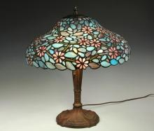 STAINED GLASS TABLE LAMP - Vintage Royal Art Glass Spelter Base, 1920's vintage, in bronze finish, two electric sockets with pull chains, having a 1970's vintage arched dome leaded slag glass shade with pink blossoms .