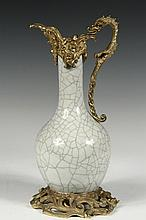 JAPANESE VASE FITTED AS EWER - 19th c. Ovoid Crackle-Glazed Vase with long neck, fitted for use as an ewer, having French gilt bronze dragon form handle and ornate spout, reticulated Art Nouveau foot, converted circa ...
