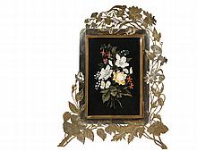 FRAME WITH PIETRA DURA PLAQUE - 19th c. Italian Tabletop Frame with integral easel, hinged brass-framed cover of pietra dura floral spray under glass, the frame itself having a surround of engraved, partially silvered...