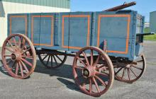 CORN WAGON - Heavy duty corn or grain wagon, high sides, open body with driver's platform, heavy duty wheels with front suspension springs, hinged rear dispensing door, old blue paint with later orange highlights, on ..