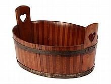 FOLK ART WOODEN BASIN - Oval Iron Banded Basin made of alternating slats of poplar and mahogany, the largest slats at the ends with sta