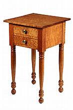 FEDERAL PERIOD WORKSTAND - Sheraton Two Drawer Stand in solid bird's-eye maple, with overhanging top, later brass knobs, ring turned l